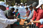 Demonstration on hygiene and hand washing at Balanagar Bus Stop.